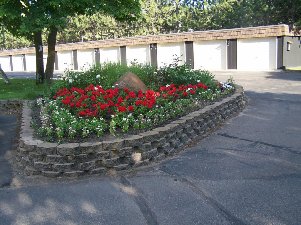 Tough Stone Raised Flower Bed Colorful Flowers Paved Shady Trees